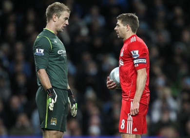 Steven Gerrard eyeballs Joe Hart before taking a penalty last night.