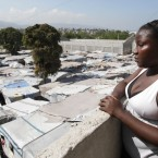 Nadia Almeda who was rehoused by Irish NGO Concern  looks down on a temporary camp in Port-au-Prince - 550,000 people in Haiti still live in them two years after the earthquake. Image: Niall Carson/PA Wire