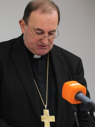 Belgian bishop Guy Harpigny looks down during a media conference in Brussels today