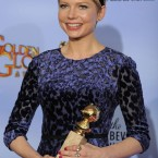Michelle Williams poses with her award for Best Actress in a Motion Picture Comedy or Musical for her portrayal of Marilyn Monroe in My Week With Marilyn. (AP Photo/Mark J Terrill/PA Images)