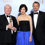 Downton Abbey creator Julian Fellows with the show's stars Elizabeth McGovern and Hugh Bonneville after winning the Best Mini-Series or Motion Picture Made for Television award. (AP Photo/Mark J Terrill/PA Images)
