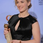 Kate Winslet with her award for Best Actress in a Mini Series or TV Movie for Mildred Pierce. (AP Photo/Mark J Terrill/PA Images)