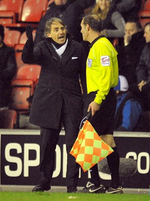 Mancini appealing to the assistant referee last night.