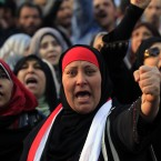 Protesters chant slogans at a rally honoring those killed in clashes with security forces in Tahrir Square nearly a year after the 18-day uprising that ousted President Mubarak. Activists are trying to energise the public to demand that the ruling military step down. (AP Photo/Khalil Hamra/PA Images)