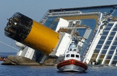Woman's body found in corridor of capsized Costa Concordia