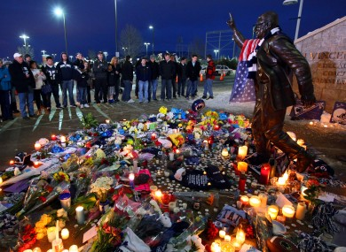 A crowd gathers to pay respects to longtime football coach Joe Paterno at his statue outside Beaver Stadium.