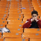 A San Francisco 49ers fan sits in the stands thinking after the team lost to the New York Giants in overtime of the NFC Championship NFL football game Sunday, Jan. 22, 2012, in San Francisco. (AP Photo/Julie Jacobson)