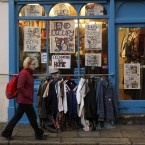 Traders on Fownes Street in Dublin's Temple Bar put up posters calling for the Occupy Dame Street camp to be dismantled. Photograph: Niall Carson/PA Wire