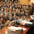 Almost one year to the day since the outbreak of an uprising that toppled Mubarak's regime, Egypt's newly-elected parliament speaker Saad el-Katatni addresses the parliament's inaugural session. Islamists dominate the 498-seat chamber that will oversee the drafting of a new constitution. (Khaled Elfiqi/AP/Press Association Images)