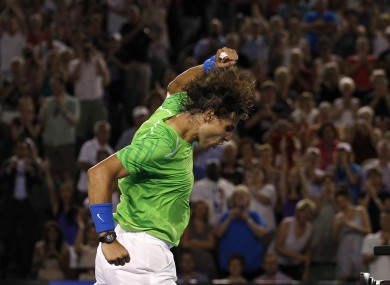 Rafael Nadal punches the air in delight after beating Tomas Berdych to book his place in the Australian Open semi-finals.