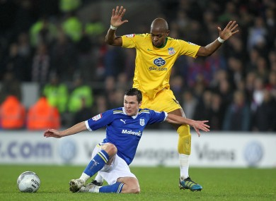 Cardiff City's Don Cowie and Crystal Palace's Anthony Gardner battle for the ball.