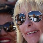 President Barack Obama is reflected in a pair of sunglasses as he shakes hands following a speech at UPS, Thursday, Jan. 26, 2012, in Las Vegas. (AP Photo/Haraz N. Ghanbari)
