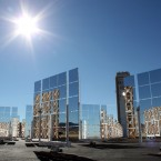 The sun shines above the field of mirrors that make up the National Solar Thermal Test Facility at Sandia National Laboratories in Albuquerque, New Mexico, on Thursday, Jan. 26, 2012. (AP Photo/Susan Montoya Bryan)