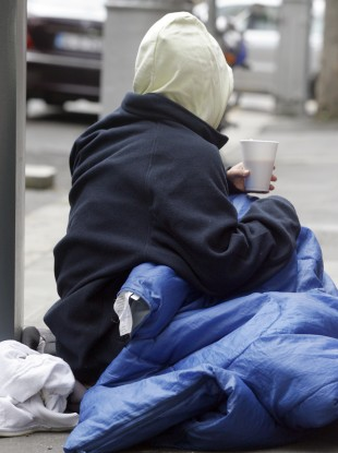 A homeless woman, Chantal, begging in Dublin.