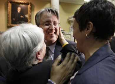 Openly-gay senator Richard Madaleno hugs Maggie McIntosh and Heather Mizeru after the Senate approved a gay marriage bill