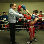 Fianna Fail leader Micheal Martin throws a few punches in the ring with James Keenan in the Glen Boxing Club in Cork City while out canvassing in the county with candidate Billy Kelleher. (Photo: Julien Behal/PA Wire)