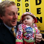 Fine Gael Leader Enda Kenny meets May Hennelly (6 months) outside Golden Island Shopping centre in Athlone during his tour of the midlands (Photo: Julien Behal/PA Wire)