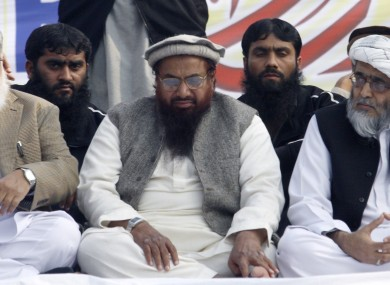 Hafiz Saeed, centre, the leader of a banned Islamic group Jamaat-ud-Dawa, an alias of the proscribed Lashkar -e-Taiba terror group,