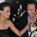 Uggie, Jean Dujardin and Berenice Bejo arrive at the AFI gala screening of