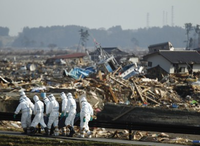 Japanese police officers during the search and recovery operation after the earthquake and tsunami in Japan last March