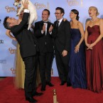 Uggie and other cast and crew members from The Artist during the 69th Annual Golden Globe Awards last month in Los Angeles. (AP Photo/Mark J. Terrill/PA Images)