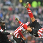 Sunderland's Wes Brown (right) takes a tumble as he collides with team mate Kieren Richardson.