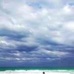 Surfers walk the shoreline as clouds roll in on South Point in Miami Beach, Flordia. (AP Photo/CX Matiash)