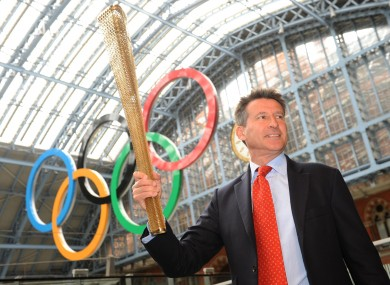 London 2012 chairman Sebastian Coe holding the Olympic torch in London