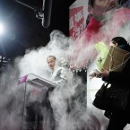 An unidentified woman, right, throws flour on French Socialist Party candidate for the 2012 presidential elections, Francois Hollande last night (AP Photo/SZG)