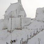 The frost-covered Wendelstein church, Germany's highest, near Bayrischzell. (AP Photo/Matthias Schrader)