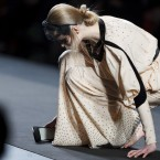A model falls while displaying an Autumn/Winter design by Miguel Palacio during the Madrid's Mercedes Benz Fashion Week. (AP Photo/Daniel Ochoa de Olza)