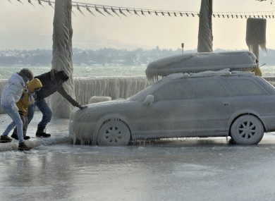 A frozen car parked by Lake Geneva in Versoix, Switzerland.
