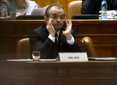Emil Boc adjusts his glasses at the Romanian parliament in Bucharest last month. 
