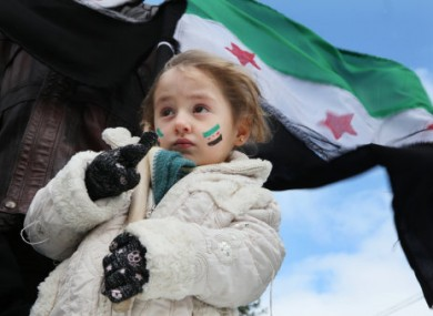 A young Syrian girl wears face paint representing the revolutionary flag during an anti-regime protest in Libya yesterday.