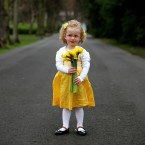 Kacey Gray, aged 3, holds a bunch of daffodils in St Stephen's Green, Dublin to celebrate the 25th birthday of the Irish Cancer Society's Daffodil Day. Image: Julien Behal/PA Wire