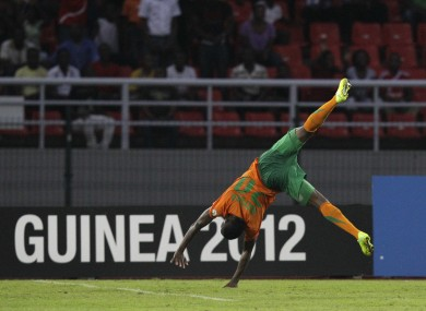 Zambia's Emmanuel Mayuka does a cartwheel after scoring against Ghana. Zambia won 1-0 to qualify for Sunday's final