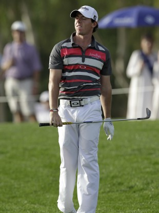 Rory McIlroy reacts to an approach shot on the 15th hole.