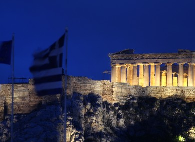 The Greek and EU flags fly in Athens yesterday