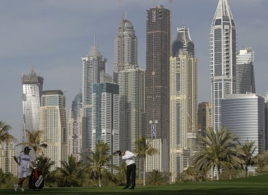 McIlroy takes a shot on the 13th hole of the Dubai Desert Classic today.