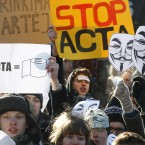 Activists protest against ACTA, in front of the Government palace in Vilnius, Lithuania. (AP Photo/Mindaugas Kulbis/PA Images)