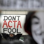 Protesters hold banners during today's anti-ACTA protest in Sofia, Bulgaria. (AP Photo/Valentina Petrova/PA Images)
