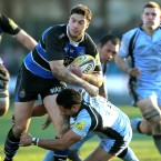 Bath's Matt Banahan bursts through the tackle of Newcastle's Suka Hufanga during the Aviva Premiership match at the Recreation Ground, Bath.