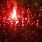 Legia Warszawa soccer fans burn flares in front of the National Stadium as they protest against the cancellation of their team's game in the Polish Supercup against Wisla Krakow, Warsaw, Poland. (AP Photo/Czarek Sokolowski)