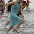Participants run in the Columbia River during the Polar Plunge at Broughton Beach, in Portland, Oregon, USA. (AP Photo/Rick Bowmer)