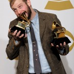 Justin Vernon aka Bon Iver poses backstage with his awards (AP Photo/Mark J. Terrill)
