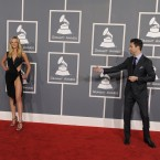 The shy and retiring Adam Levine and Anne Vyalitsyna arriving at the 54th annual Grammy Awards (AP Photo/Chris Pizzello)