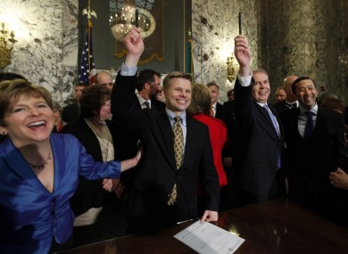 Politicians at the signing of the law yesterday in Olympia, Washington.