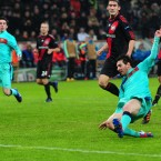 Barcelona's Lionel Messi scores their third goal against Bayer Leverkusen on Tuesday night.
