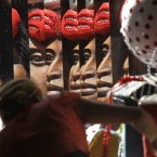 A woman works on a carnival float at the Mocidade Independente de Padre Miguel samba school in Rio de Janeiro, Brazil. (AP Photo/Silvia Izquierdo)