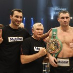 WBC heavyweight Champion Vitali Klitschko  of Ukraine, right,  celebrates with his brother Wladimir , left, and coach Fritz Sdunek after winning the WBC heavyweight title bout against boxer Dereck Chisora of Britain at the Olympic hall in Munich, Germany , Sunday, Feb. 19, 2012. (AP Photo/Frank Augstein)